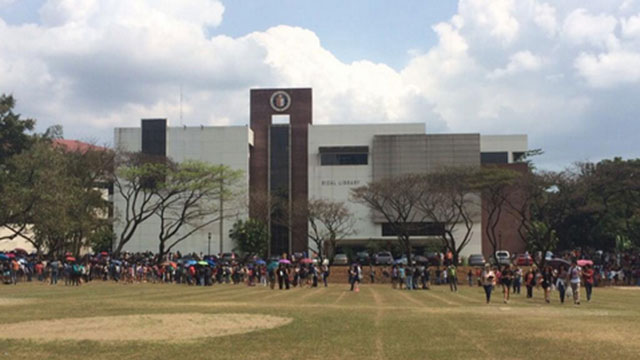 EVACUATED. Ateneo de Manila students and personnel evacuate the campus after a text message regarding a bomb threat spread on Wednesday, February 12. Photo from Colene Arcaina