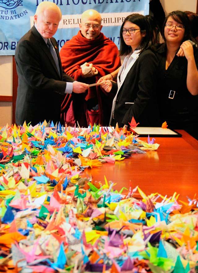 YOLANDA DONATIONS. Ambassador Cuisia with members of the Vietnamese community who turned over donations for victims of Typhoon Yolanda. Photo by Majalya Fernando/Philippine Embassy
