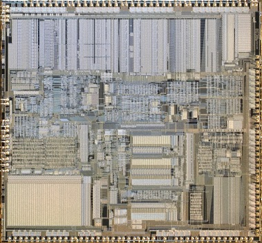 Intel 386 CPU die photo (A80386DX-20). By Pdesousa359, https://commons.wikimedia.org/wiki/File:Intel_A80386DX-20_CPU_Die_Image.jpg (CC BY-SA 3.0)