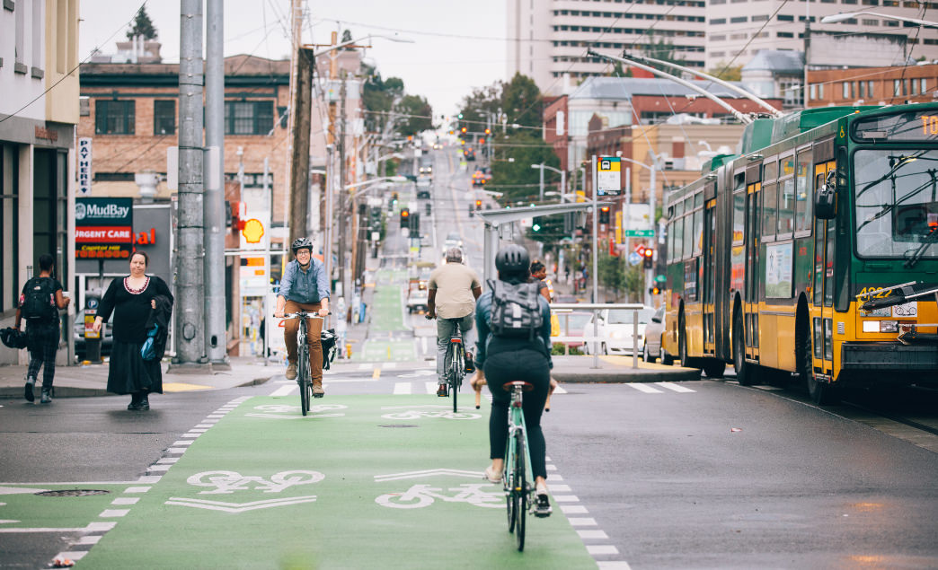 Cyclists Ride the Green Lanes in Seattle