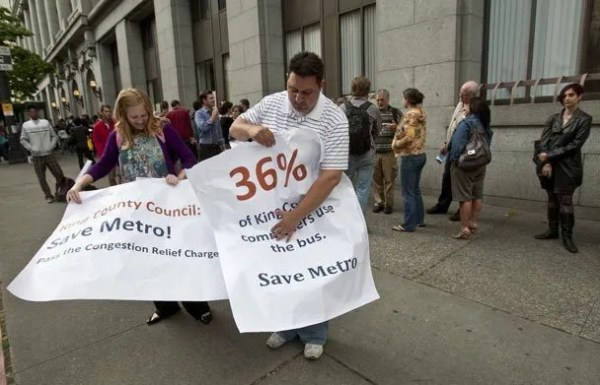 Crowd lines up to oppose Metro bus cuts | The Seattle Times