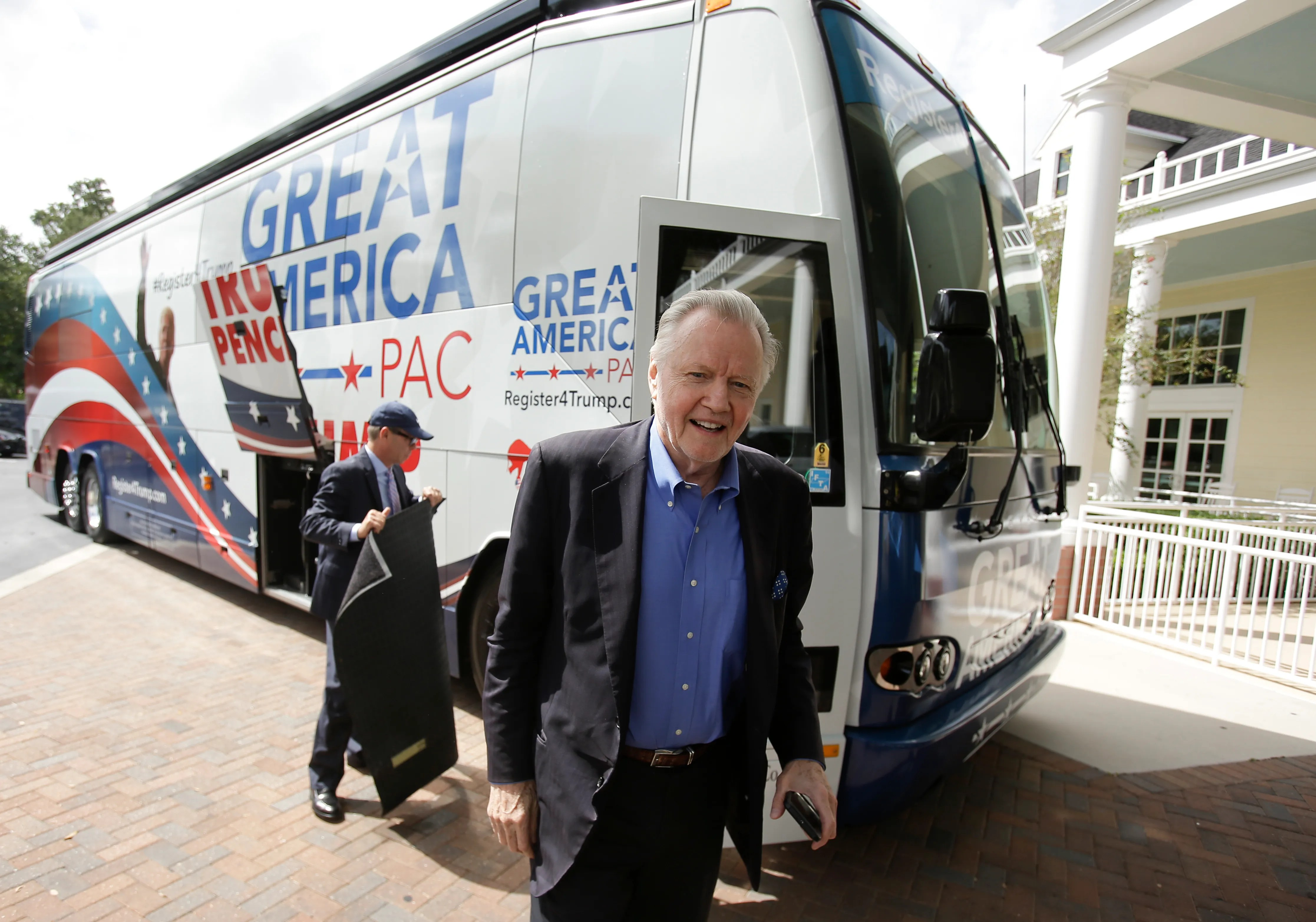 In this Monday, Sept. 12, 2016 photo, conservative actor and Donald Trump supporter Jon Voight arrives on the Great America PAC bus for a town hall meeting in Lake Mary, Fla. (AP Photo/John Raoux)