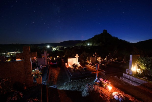 Candles illuminate graves ahead of All Saints' Day in the cemetery of the village of Hajnacka, or Ajnacsko in Hungarian,  near the Hungarian border, Slovakia, October 30, 2016.