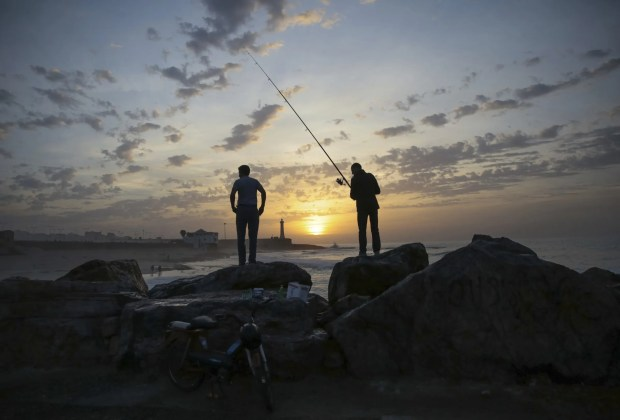 Fishermen wait for a catch on Rabat beach, Morocco, on Wednesday, Nov. 2, 2016. Rabat beach is a hub for families, couples and fitness enthusiasts especially on temperate days.