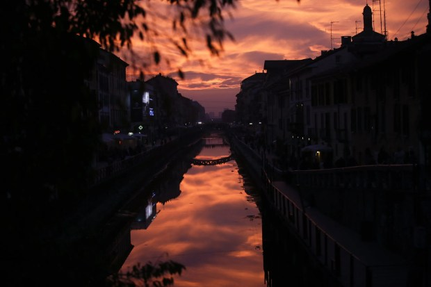 The sun sets over the Naviglio Grande canal, in Milan, Italy, Wednesday, Nov. 2, 2016.