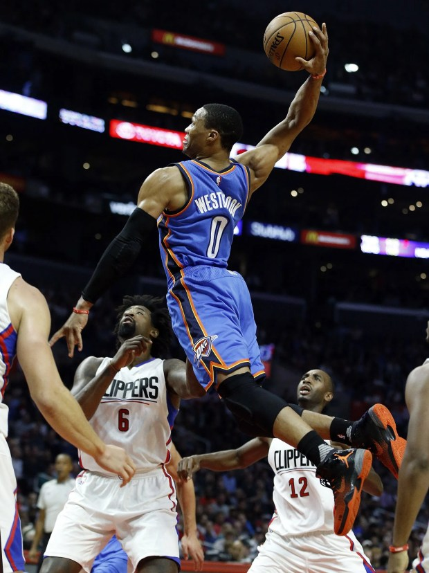 Oklahoma City Thunder guard Russell Westbrook (0) goes up for a dunk over Los Angeles Clippers center DeAndre Jordan (6) and forward Luc Richard Mbah a Moute (12) during the first half of an NBA basketball game in Los Angeles, Wednesday, Nov. (0) goes up for a dunk over Los Angeles Clippers center DeAndre Jordan (6) and forward Luc Richard Mbah a Moute (12) during the first half of an NBA basketball game in Los Angeles, Wednesday, Nov. 2, 2016. The Thunder won 85-83. (AP Photo/Alex Gallardo)