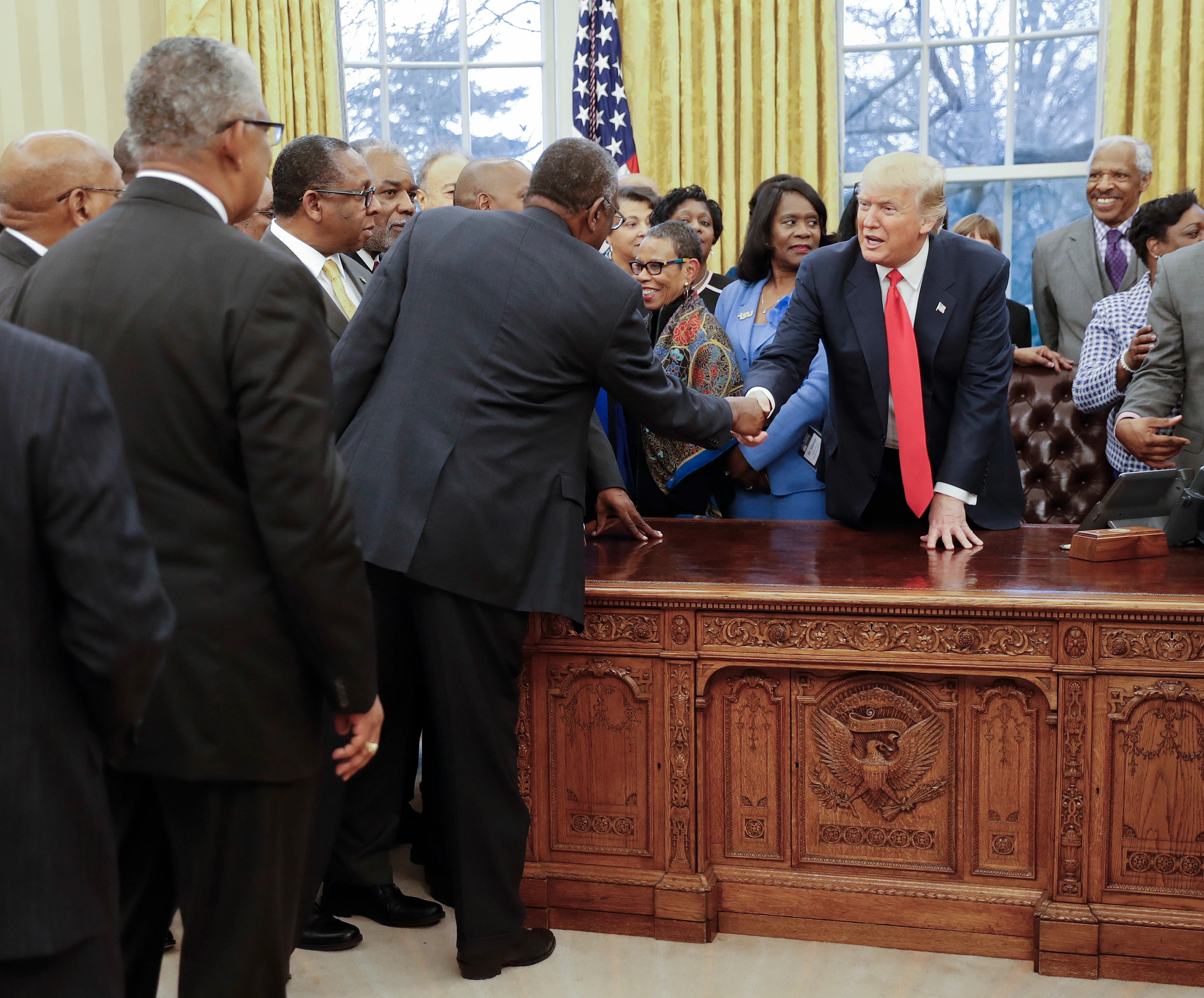 President Donald Trump shakes hands as he meets with leaders of Historically Black Colleges and Universities (HBCU) in the Oval Office of the White House in Washington, Monday, Feb. 27, 2017. (AP Photo/Pablo Martinez Monsivais)