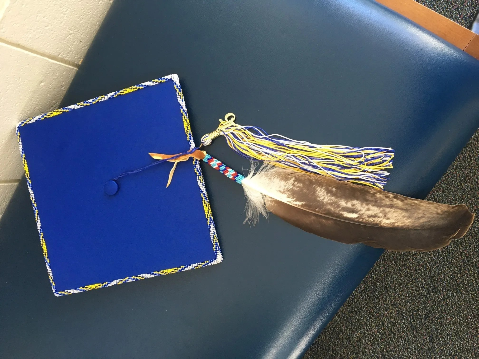 School District Changes Rule To Allow Feathers On Grad