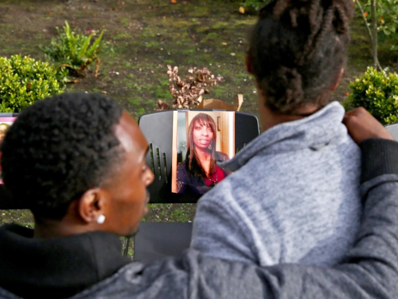 People Attend A Memorial For Charleena Lyles Seen In A Photo At Center Who
