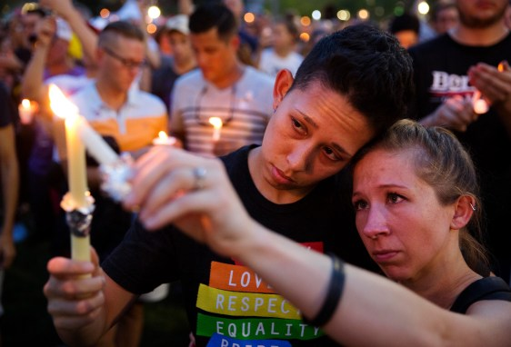 Jennifer, right, and Mary Ware at a vigil in Orlando, Florida, June 13, 2016, a day after a mass shooting at the Pulse nightclub. (David Goldman/AP)
