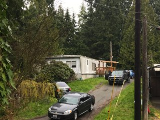 """FBI agents on Tuesday morning blocked access to the Everett-area home where Thanh Cong Phan lives. The 43-year-old man has been arrested in connection with suspicious packages containing """"potential destructive devices"""" that were mailed to multiple U.S. military installations and to CIA headquarters in the Washington, D.C., area, the FBI announced early Tuesday.  (Christine Willmsen / The Seattle Times)"""