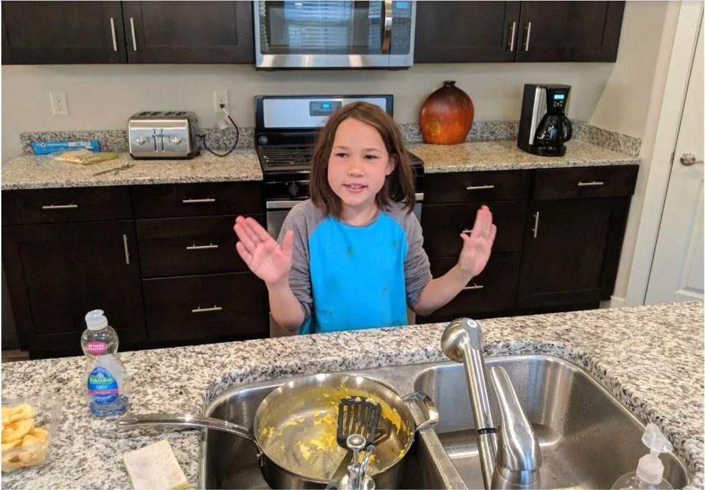 Erysse Elliott prepares to clean a pan after breakfast in a Vacasa home rental in St. George, Utah. (Christopher Elliott)