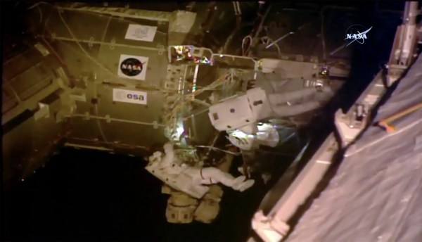 Spacewalking astronauts set up TV cameras for arriving