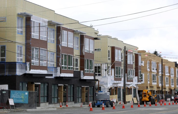 The idea of allowing developers to build one or several stories higher in exchange for including, or paying for, some low-income apartments is a good one. But our plan was hatched behind closed doors, in meetings not open to the public. (Ken Lambert / The Seattle Times)