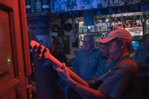 Bill Slusser, center, sings with friends Fil Formicola, left, and Dilia Suriel at a bar in San Miguel. Slusser has built a community of friends with whom he sings karaoke on the weekends. (Photo for The Washington Post by Luis Antonio Rojas).