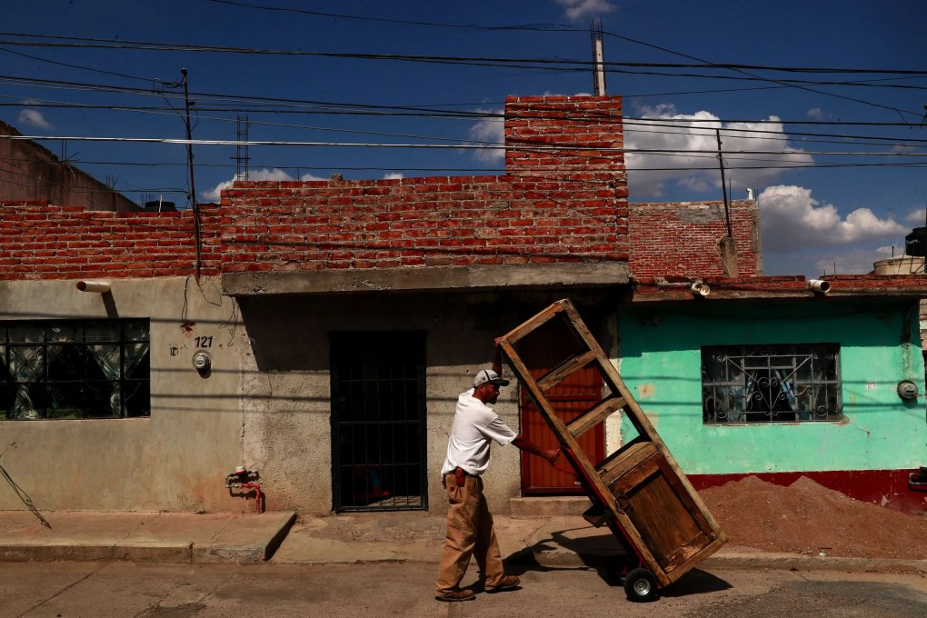 Rafael moves furniture he built in his carpentry shop to his house. (Erika Schultz / The Seattle Times)
