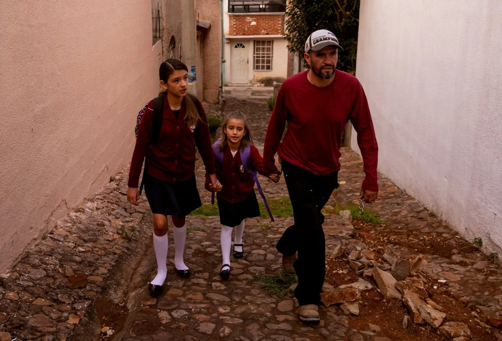 Rafael walks Maya and Catalina to school. The girls have lived in Mexico and the U.S. and have dual citizenship. (Erika Schultz / The Seattle Times)