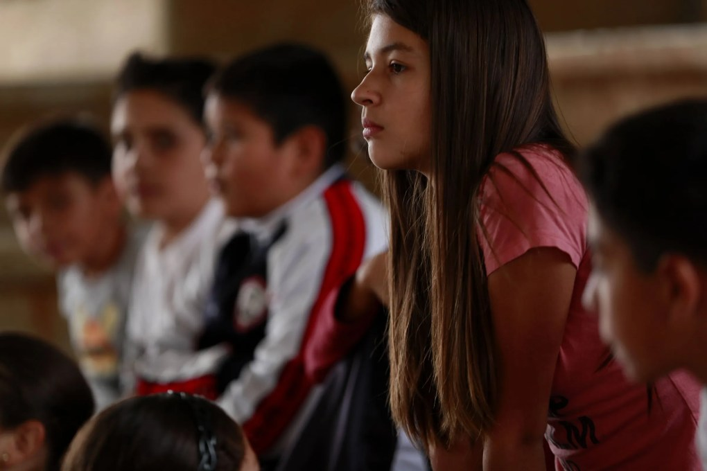 Maya Valdez listens during a school activity in which she and schoolmates act out skits they wrote. (Erika Schultz / The Seattle Times)
