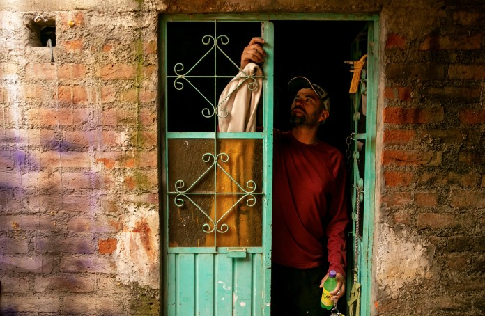 Rafael opens the door to his carpentry shop. In the United States, he worked up to three jobs to help pay for the family home in Zacatecas. (Erika Schultz / The Seattle Times)