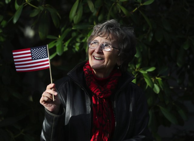 """Marta Boros Horvath, shown at her Seattle home Monday, Oct. 26, 2020, took the final step toward naturalization by completing her citizenship interview in October. After being here since the 1960s, Horvath will vote for the first time in the Nov. 3 election. """"I want this country to stay democratic because that's why I'm here,"""" said Horvath, 78, who arrived in the U.S. at age 24 from Hungary.  (Ken Lambert / The Seattle Times)"""