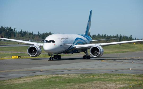 A large passenger jet sitting on an airport runwayDescription generated with very high confidence