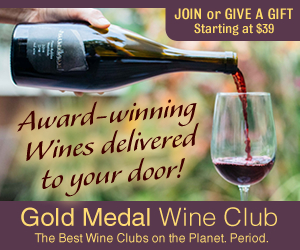 Wine glass being filled with red wine from a Gold Medal wine club wine bottle