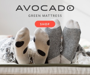couple laying on natural bed showing socks