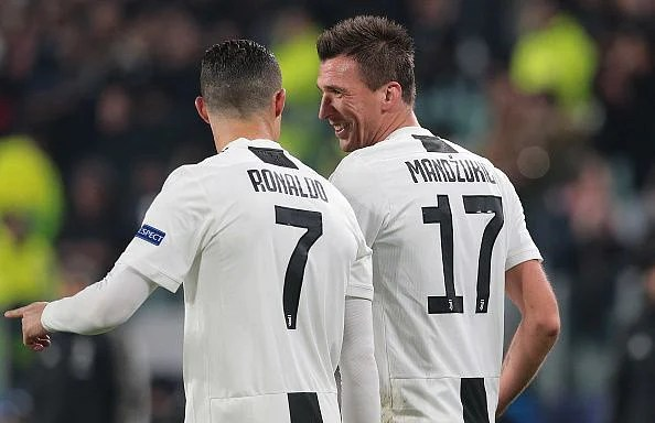 Ronaldo and Mandzukic celebrate the latter's important opener during their 1-0 win over Valencia