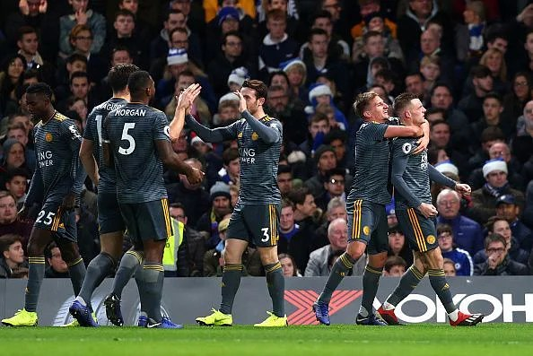Jamie Vardy (far right) celebrates his goal with teammates on an important afternoon in the Premier League