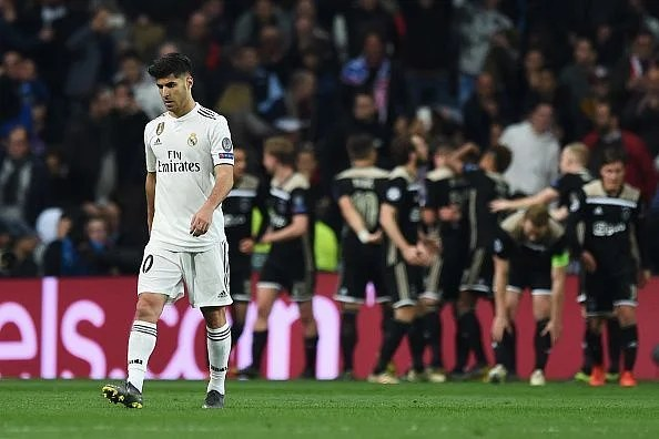 Asensio reacts as Ajax stunned Real at the Bernabeu, knocking out the defending champions in style