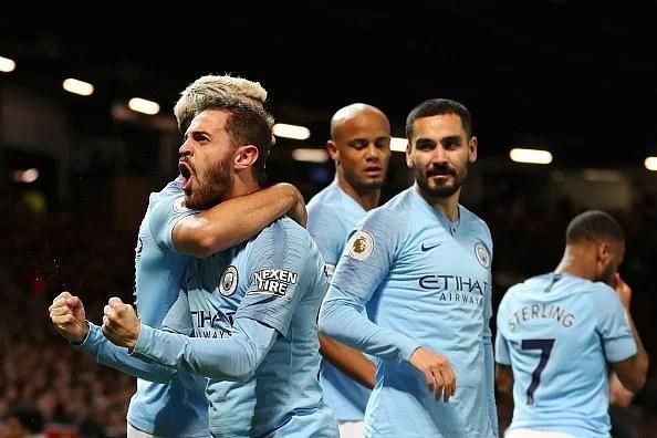 Bernardo Silva celebrates his opening strike with Manchester City teammates