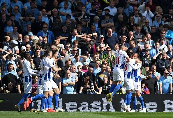 Murray and his Brighton teammates celebrate his 13th league goal of the campaign, giving them a brief lead