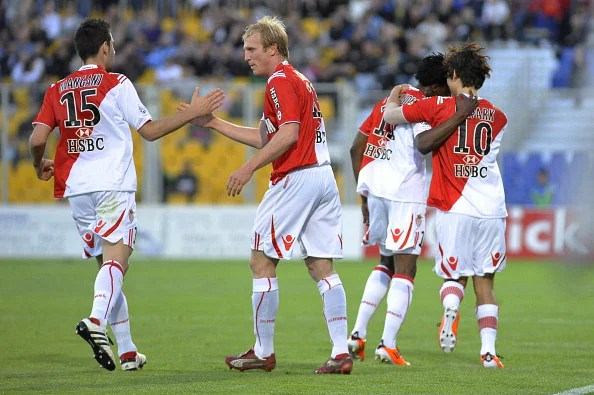 Monaco's players celebrate after a goal