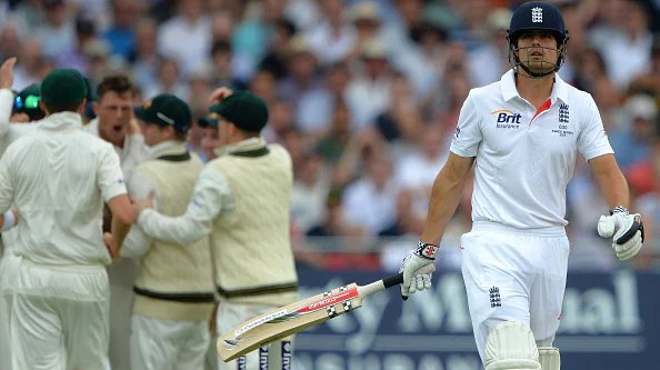 England captain Alastair Cook leaves the pitch as Australian players celebrate his dismissal during the first days play of the first cricket Test match of the 2013 Ashes series between England and Australia at Trent Bridge