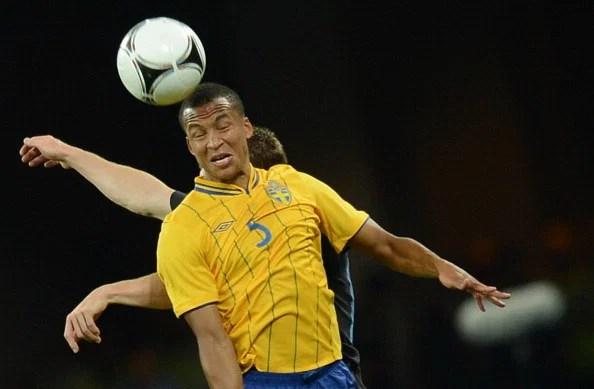 Swedish defender Martin Olsson heads the