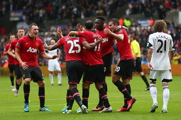 Danny Welbeck (3R) of Manchester United celebrates with team mates after scoring his sides second goal during the Barclays Premier League match between Swansea City and Manchester United at the Liberty Stadium on August 17, 2013 in Swansea, Wales. (Getty Images)
