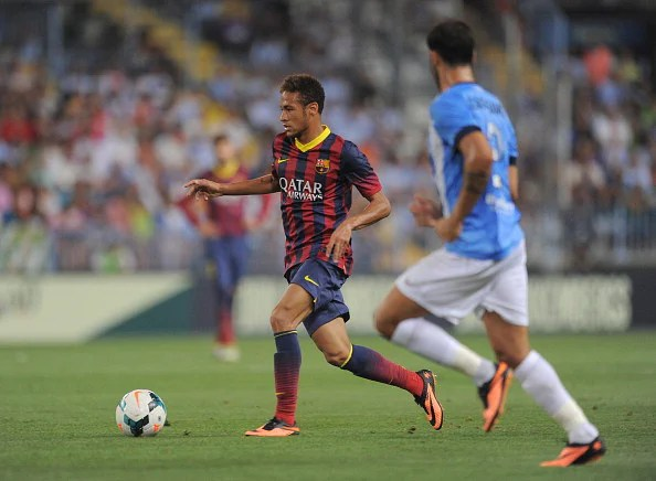 Neymar (L) of FC Barcelona in action during the La Liga match between Malaga CF and FC Barcelona at La Rosaleda Stadium on August 25, 2013 in Malaga, Spain.  (Getty Images)