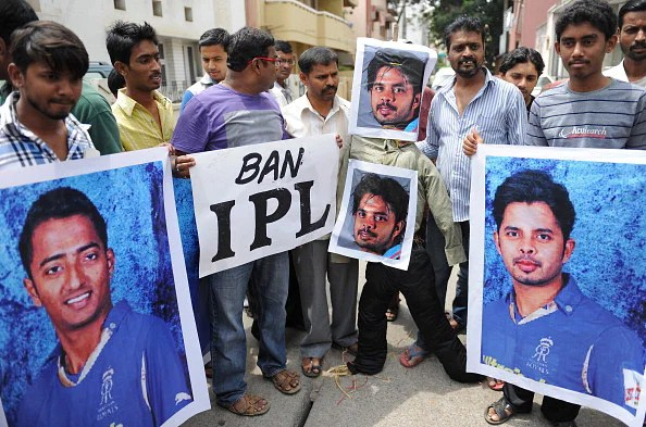 Demonstrators hold posters and shout slogans against Indian cricketer Sreesanth and two other domestic Twenty20 cricketers