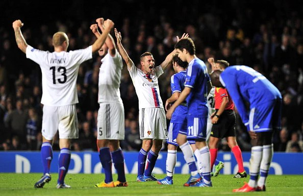 FC Basel's Swiss midfielder Fabian Frei (C) celebrates winning the UEFA Champions League Group E football match against Chelsea at Stamford Bridge