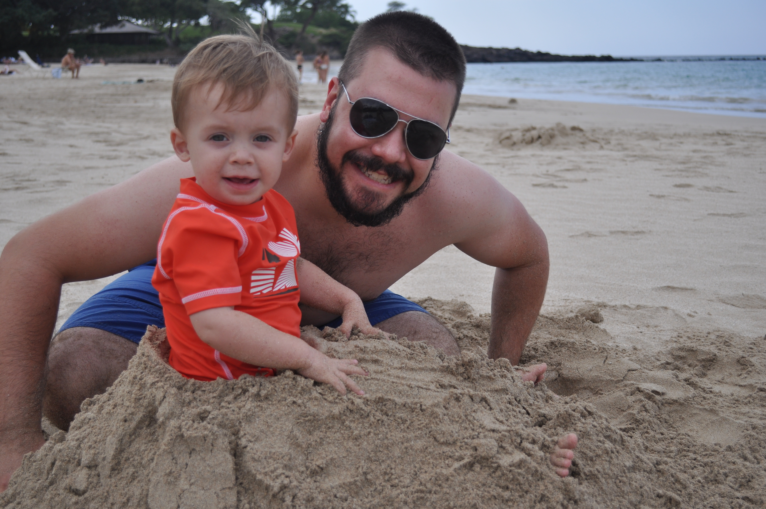 Daddy buried Ian in the sand!