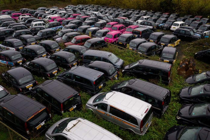 <p>Over 200 black cabs are stored in the field in Epping</p>