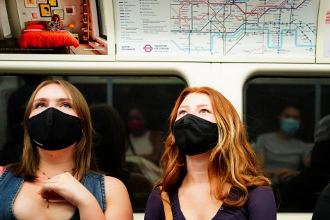 Facemasks were made mandatory for travelling on public transport in England in June, but it was not until July that they were required inside shops (Victoria Jones/PA)