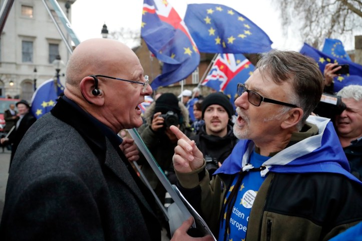 A Leaver and a pro-European demonstrator argue during protests opposite the Houses of Parliament in London AP