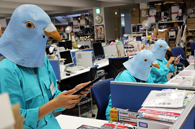 Employees of Japanese toy company Tomy dressed as Twitter birds work at their desks during the company's Halloween Day event at the company headquarters in Tokyo on October 27, 2015. Employees for the Japanese toymaker were allowed to wear their favourite costumes in observance of the holiday.  AFP PHOTO / Yoshikazu TSUNO / AFP / Yoshikazu TSUNO        (Photo credit should read YOSHIKAZU TSUNO/AFP/Getty Images)