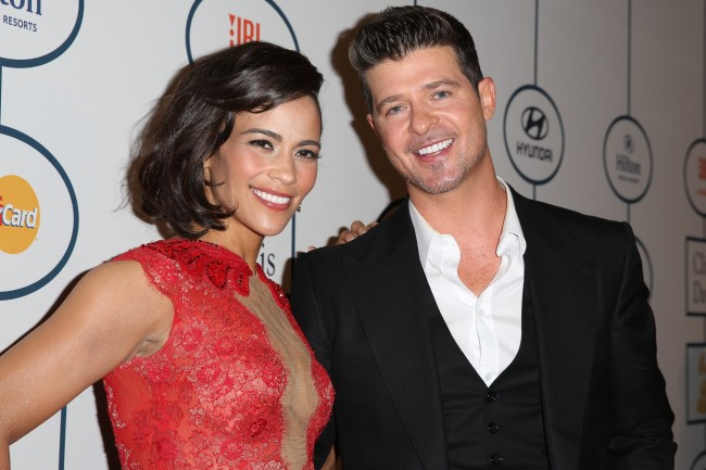 BEVERLY HILLS, CA - JANUARY 25:  Paula Patton (L) and singer Robin Thicke arrive at the 2014 HYUNDAI / GRAMMYs Clive Davis Pre-GRAMMY Gala Activation + Equus Fleet Arrivals at The Beverly Hilton Hotel on January 25, 2014 in Beverly Hills, California.  (Photo by Chelsea Lauren/Getty Images for Hyundai)