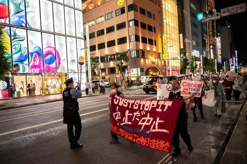 People taking part in a protest against the hosting of the 2020 Tokyo Olympic Games in Tokyo, on May 17, 2021.