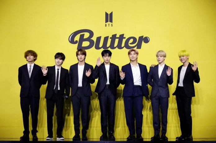 BTS' Butter debuted at No. 1 on iTunes' Top Songs chart in 101 regions.bts record YouTube views  on butter song