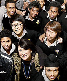 Retiring dean of international students and ESOL teacher Val Moore surrounded by her New Plymouth Boys High School students.