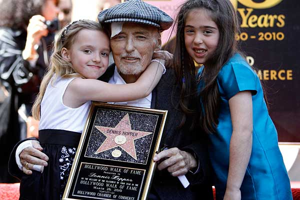 Dennis Hopper & his youngest daughter Galen after he was awarded a star on the Hollywood Walk of Fame (march 2010).