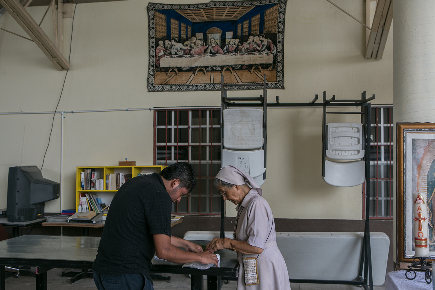 A nun helps a patient with his medication at Casa del Migrante Reynosa Guadalupe in Reynosa, Mexico, on May 2, 2017. According to the director of the shelter, the majority of the people staying at the shelter are recent deportees from the United States.